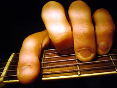 Someone who bites their fingernails playing a A# Minor (or Bb Minor) guitar chord